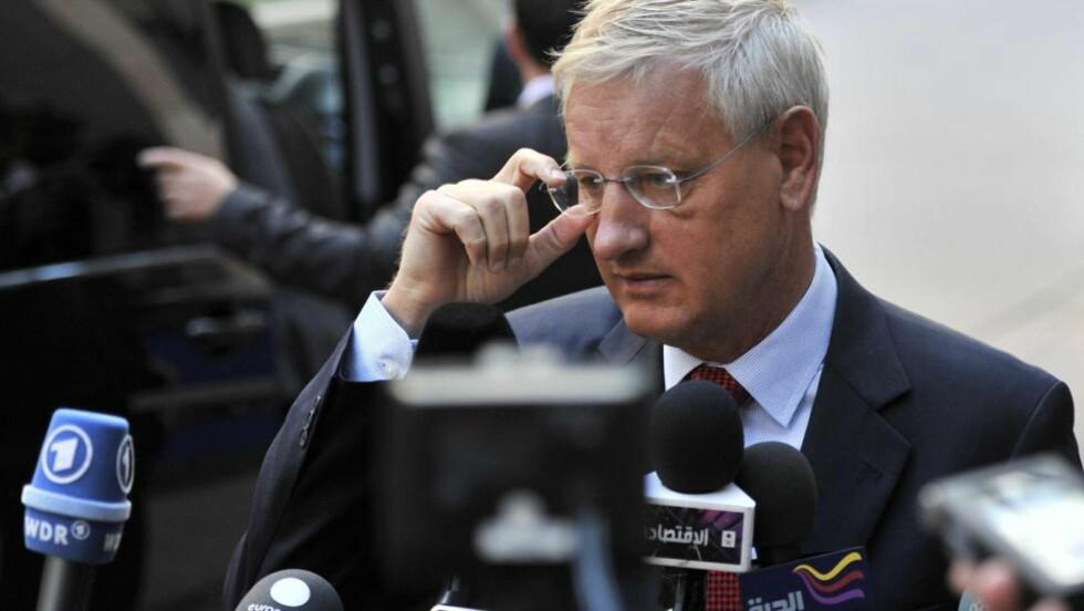 RØPER DETALJER: Utenriksminister Carl Bildt har blogget om diplomatiet som var i aksjon for å få satt fri de to svenske journalistene i Etiopia. Foto: Georges Gobet / AFP / NTB Scanpix