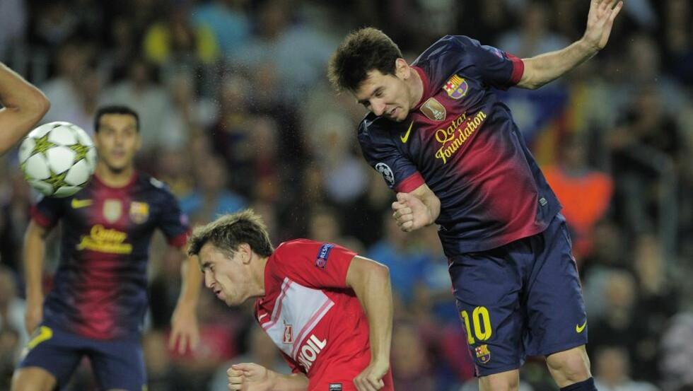 I LUFTA OGSÅ, NÅ: Leo Messi stanget inn 3-2 med ti minutter igjen å spille. Barcelona var på vei mot et sjeldent tap hjemme mot Spartak Moskva. Foto: SCANPIX/AFP/ JOSEP LAGO