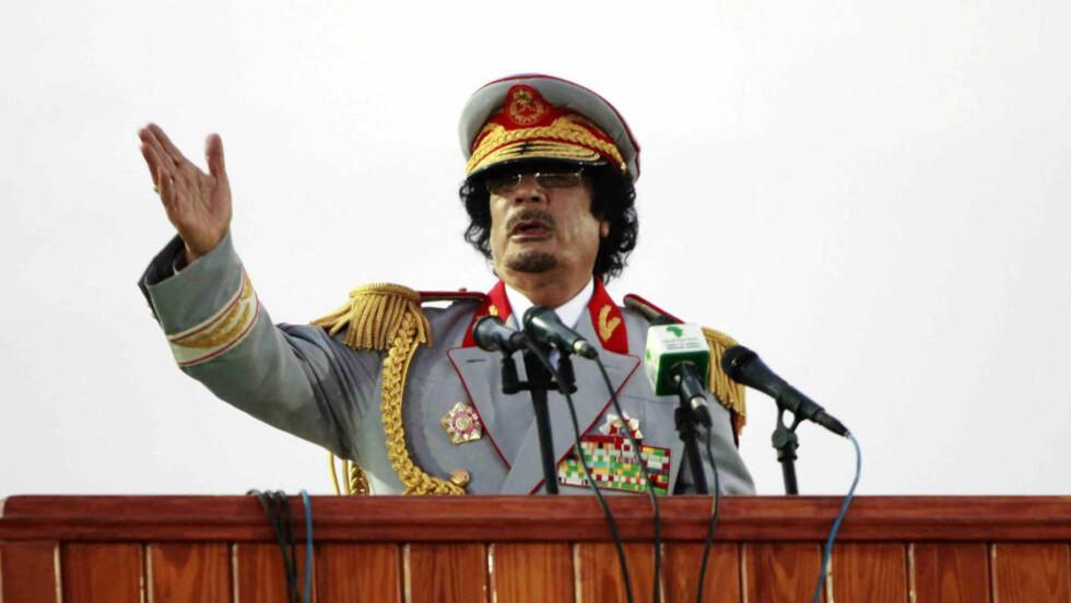 DESPOTEN: Muammar Kadhafi ble til slutt for grusom for sitt eget folk. En ny bok avslører nå detaljene om hvordan diktatoren holdt unge jenger som sexslaver i sitt eget harem. Foto: Ismail Zetouny / Reuters / NTB Scanpix.
