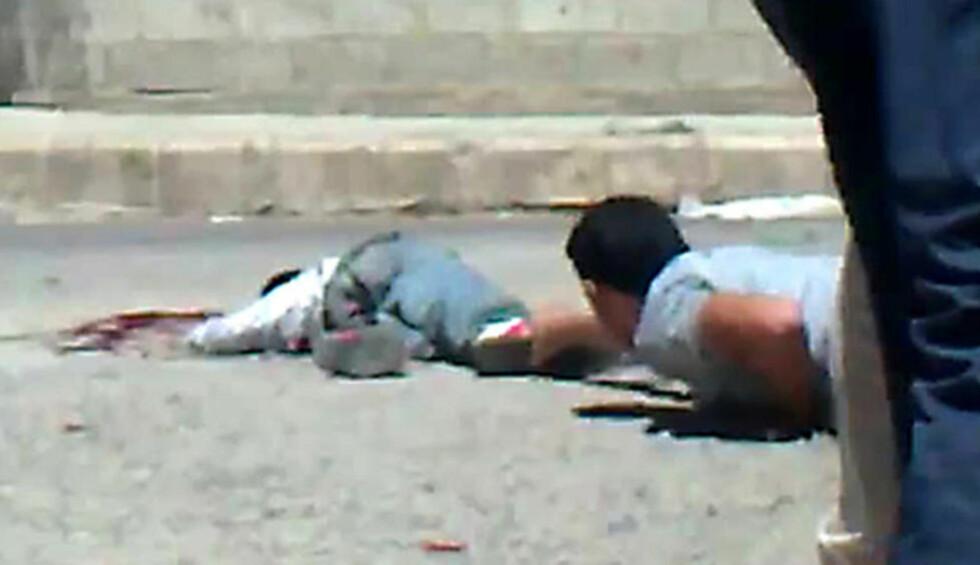 DRAMATISK:  Mohammed Bassam al-Tahhan (11)  skal ha dødd av skadene han fikk under en demonstrasjon i Deraa. Foto: AFP PHOTO/Scanpix