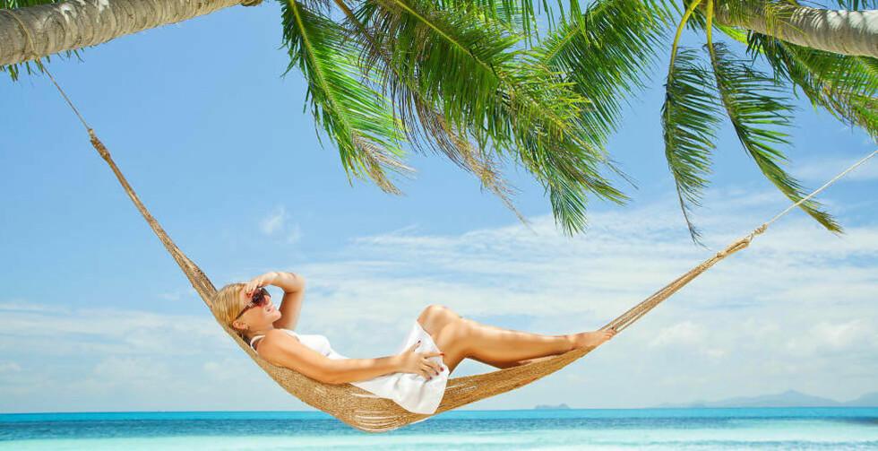 FERIEDRØMMEN: Dårlige forberedelser kan ødelegge ferien, her er ting du må sjekke før du drar. Foto: FOTALIA