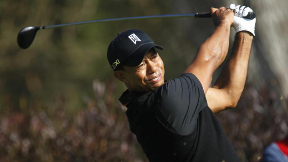 JOBBET OG SLET: Tiger Woods var en av kun tre som avsluttet dagen under par i San Francisco. Foto: REUTERS/Robert Galbraith/NTB scanpix