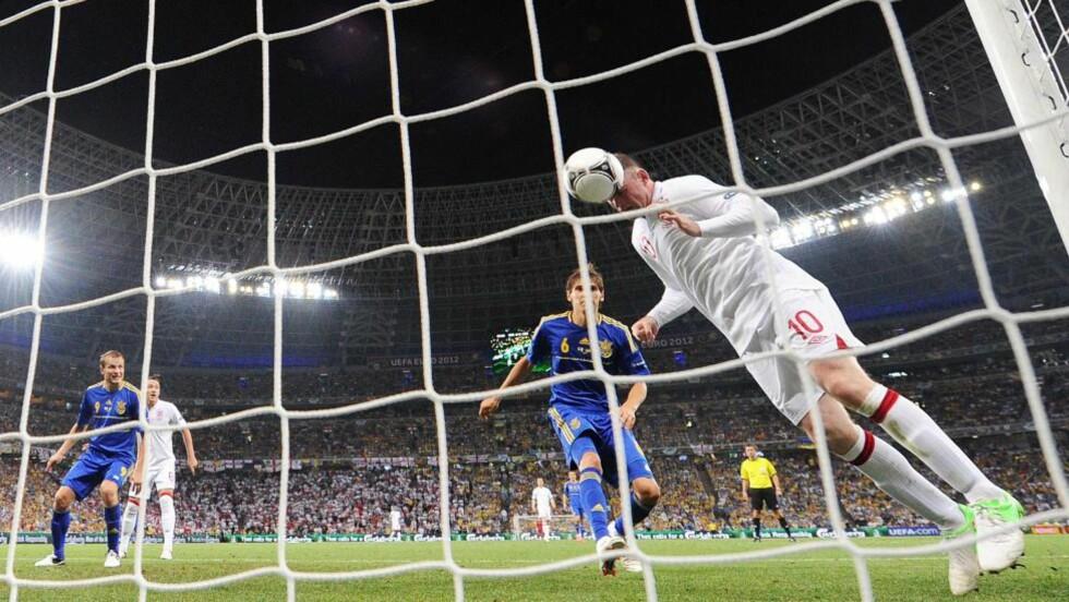ENDELIG, WAYNE: Wayne Rooney har knapt noen gang fått en scoring mer servert enn den han nikket inn etter 48 minutter mot Ukraina. Men lettelsen var så enorm for spissen at han ikke kunne brydd seg mindre om forspillet. Foto: Carl de Souza/AFP/NTB scanpix