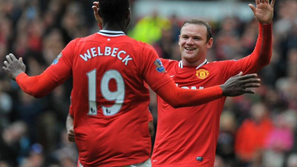 PÅ BØRSEN: Manchester United er fra denne uka på børsen i USA. Her ved Wayne Rooney og Danny Welbeck. Foto: AFP PHOTO/ANDREW YATES