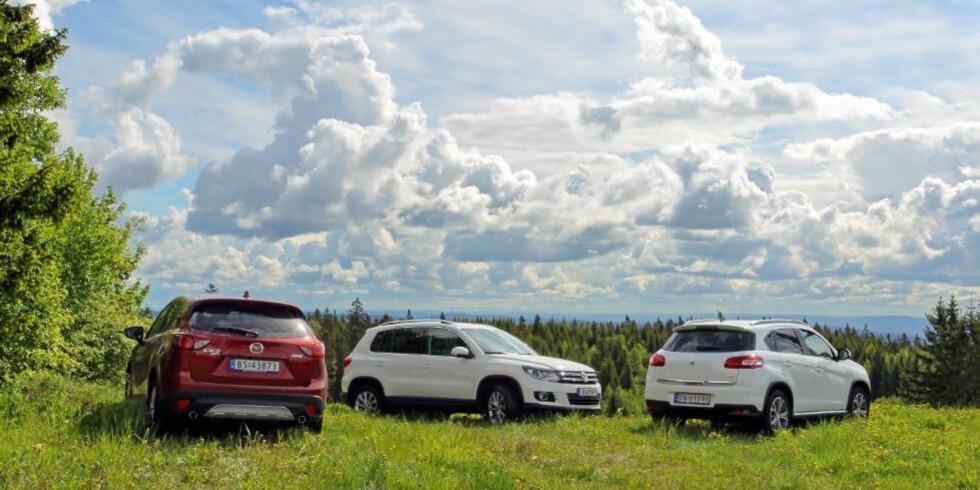 TO KJENTE: Selv om Peugeot 4008 er en ny bil, er det ikke til å komme unna at det i praksis er samme modell som Mitsubishi ASX. Derfor anser vi kun CX-5 som en helt ny modell. FOTO: Terje Bjørnsen