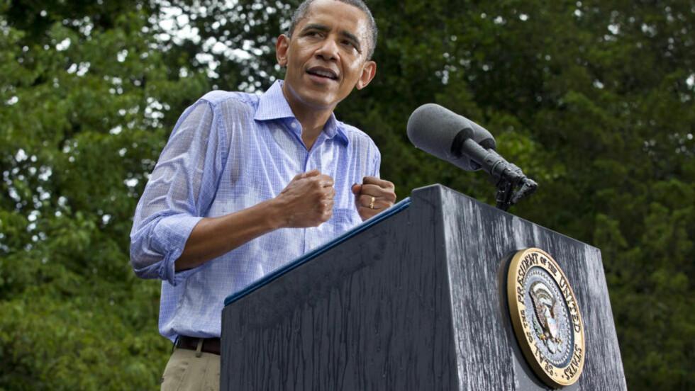 TILSPISSES: Den amerikanske valgkampen tilspisses, etter at president Barack Obama søndag lanserte en ny tv-reklame. Foto: AP Photo/J. Scott Applewhite/Scanpix