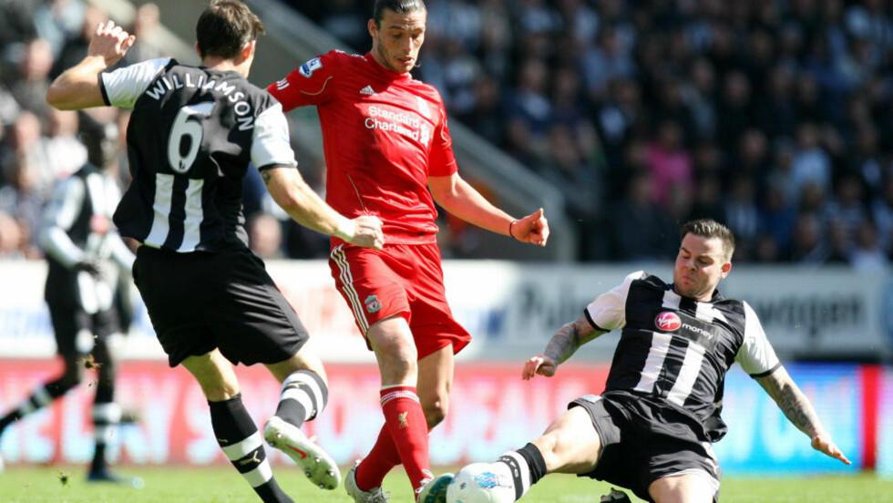 RETUR? Ifølge engelske medier har Newcastle kontaktet Liverpool for å prøve å hente Andy Carroll tilbake til St. James' Park. Foto: AP Photo/Scott Heppell