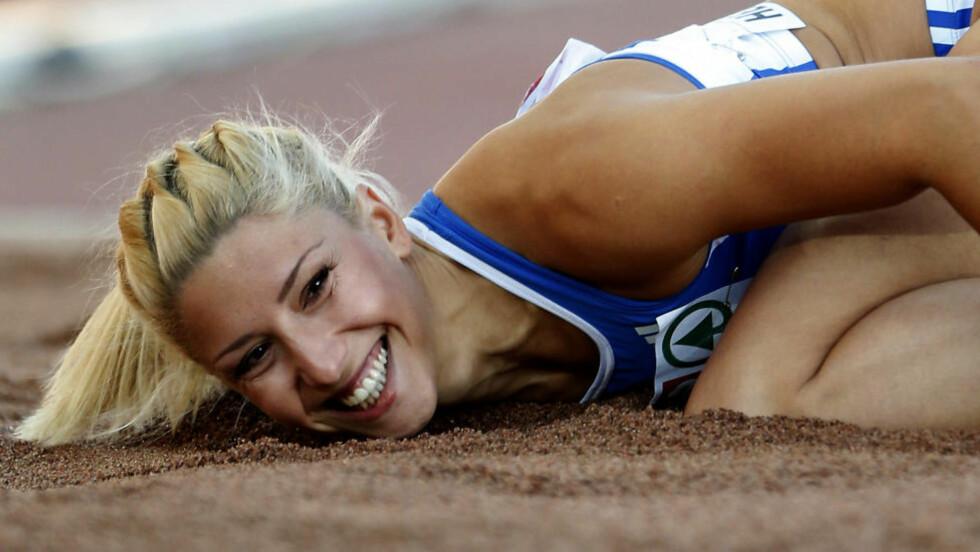 LEGGER SEG FLAT: Den greske tresteghopperen Voula Papachristou har kommet med en uforbeholden unnskyldning etter en Twitter-spøk som kostet henne deltakelsen i London-OL. Foto: AP Photo/Matt Dunham/NTB scanpix