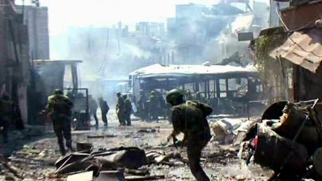 HARDE KAMPER: I dag offentligjorde det offiselle syriske nyhetsbyrået SANA disse bidlene av regimelojale soldater som slåss i Damaskus. Foto: AFP/SCANPIX