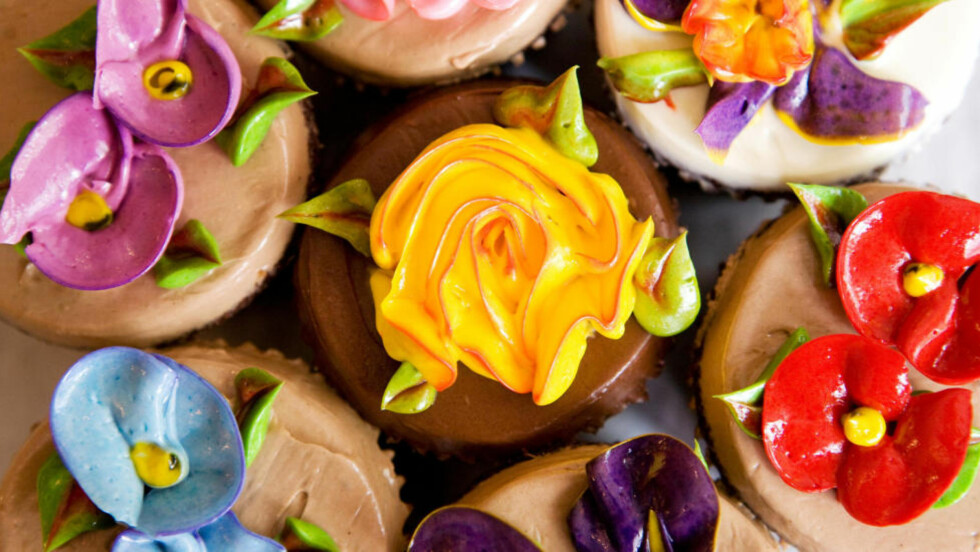 In this July 29, 2009  file photo Cupcake Cafe's cupcakes are seen in New York. The Cupcake Cafe's cupcakes are known for exquisitely beautiful butter cream frosting, designed to resemble flowers. (AP Photo/Yanina Manolova,File)