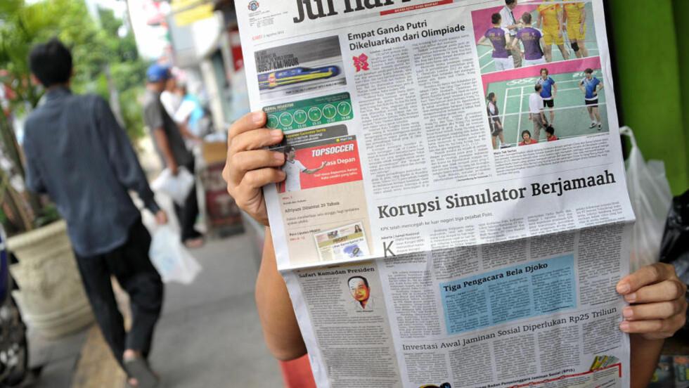 EN VERDENSSKANDALE:  De avtalte badminton-tapene er blitt avisoppslag over hele verden. Her fra en indonesisk førsteside i går. FOTO: AFP / Bay Ismoyo.