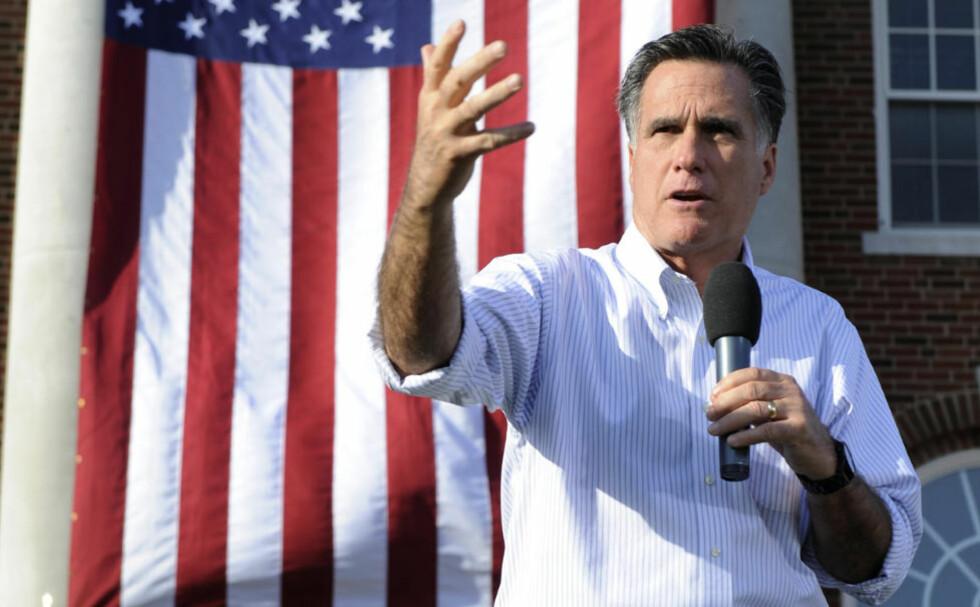 FORNØYD: Mitt Romney er begeistret over å få den høyt respekterte superstjernen med på laget. Foto: DAVE KAUP / REUTERS / NTB SCANPIX