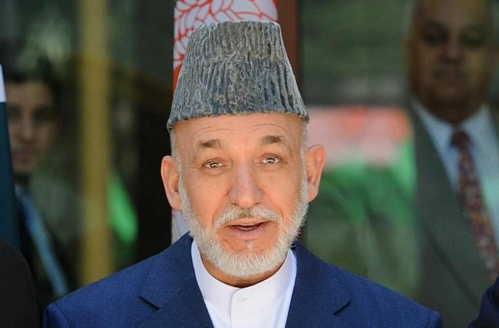 GODKJENTE AVGANG: Afghanistans president måtte la to av sine viktigste ministre gå av etter at flere tjenestefolk er blitt drept i grenseområdet til Pakistan.                                                                            Foto: Stefan Rousseau / AFP / NTB Scanpix