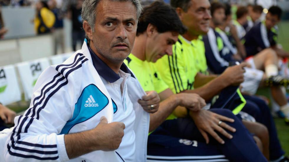 FORNYØD SJEF: Real Madrid-trener Jose Mourinho roser sitt eget mannskap. Foto: Kevork Djansezian/Getty Images/AFP