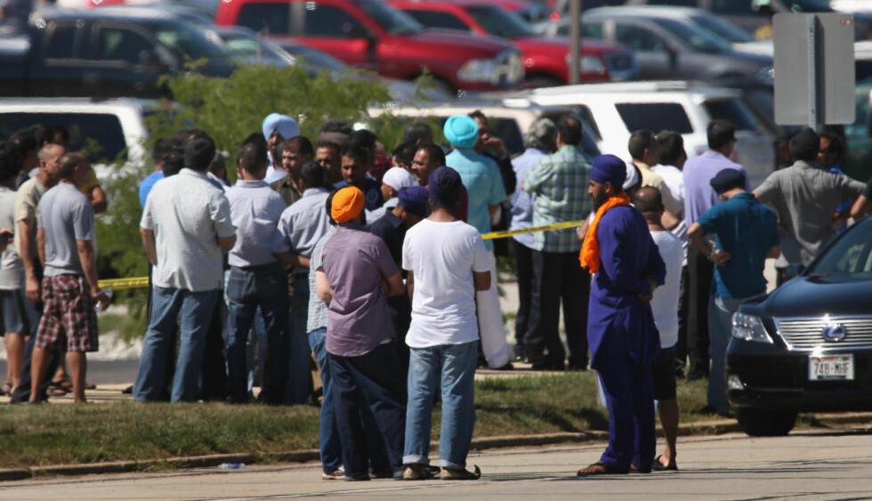 SKYTEDRAMA: Sju personer ble skutt og drept i skytedramaet i et Sikh-empel i Oak Creek, sør for Milwaukee i USA. Gjerningsmannen er en av de drepte. Politiet opplyser at angrepet etterforskes som «innenlandsk terrosisme». Foto: SCOTT OLSON / GETTY IMAGES / AFP / NTB SCANPIX