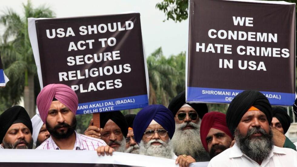REAGERER: Skytingen utløste en protest ved den amerikanske ambassaden i New Dehli i India. Foto: HARISH TYAGI / EPA / NTB Scanpix