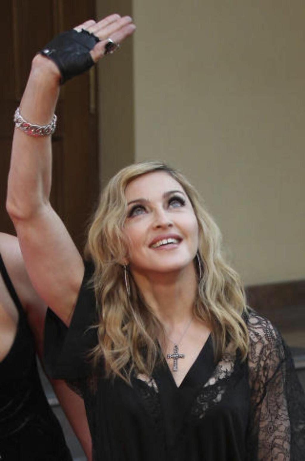 DRAR EN PATTI SMITH?: Det spekuleres i om Madonna vil støtte Pussy Riot under konserten sin i Moskva i morgen. Foto: MIKHAIL METZEL / AP PHOTO / NTB SCANPIX