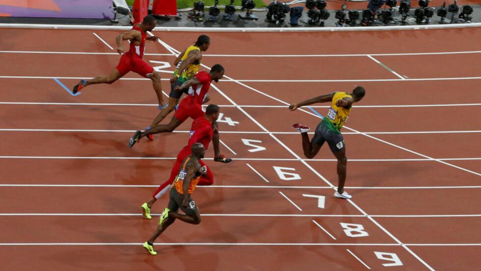 PREMIER LEAGUES RASKESTE SPILLER? Usain Bolt (t.h) var suveren i 100 meter-finalen, vinnertiden på 9,63 er OL-rekord. Foto: REUTERS/Cathal McNaughton