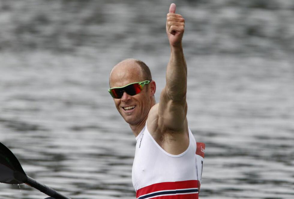 GULLGUTT: Eirik Verås Larsen jubler etter å ha blitt olympisk mester for andre gang i karrieren.  Foto: Heiko Junge / NTB scanpix