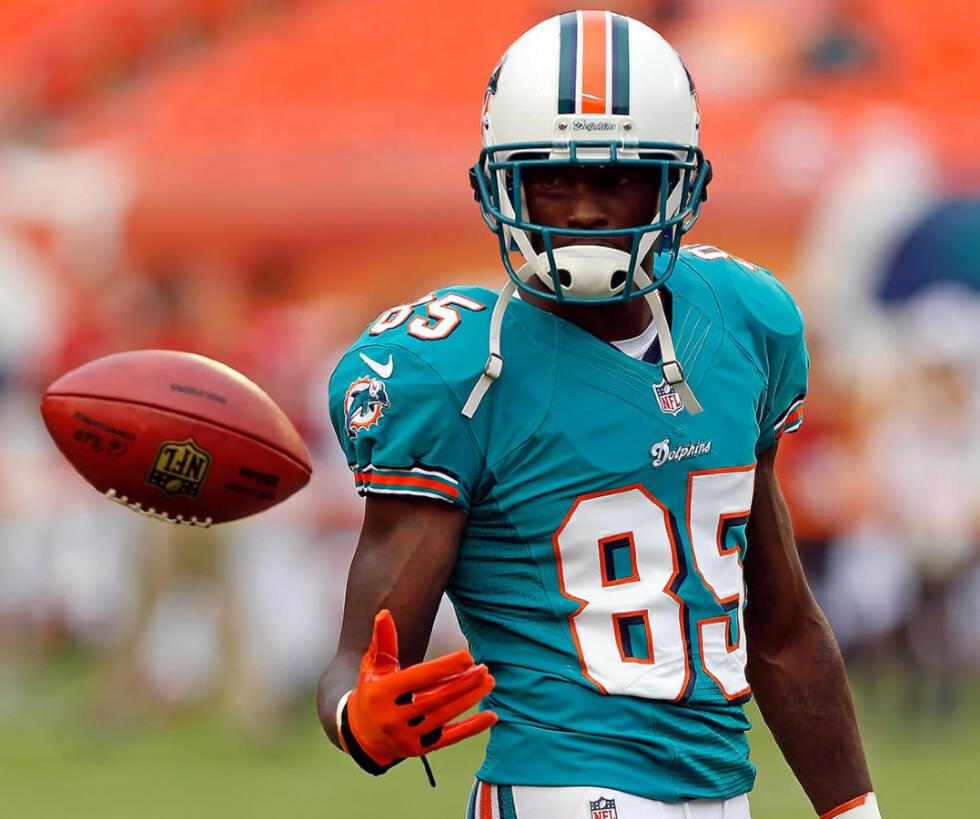 FIKK SPARKEN: Chad Johnson kom til Miami Dolphins i sommer for igjen å få fart på karrieren etter å ha spilt en helt marginal rolle i New England Patriots vei til Super Bowl forrige sesong. Nå er han ferdig før det egentlig begynte. Foto: J. Meric / Getty Images / AFP / NTB Scanpix