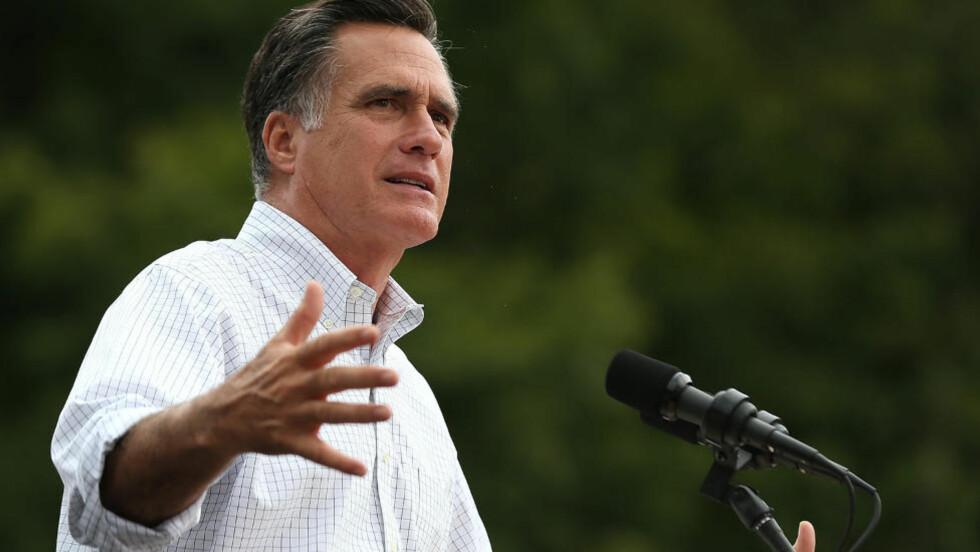 FORVIRRET?: I Florida nektet Romney mandag gjentatte ganger å svare klart på hva han mener om Medicare. På bildet står han på talestolen i Ohio. Foto: Justin Sullivan / Getty Images / AFP
