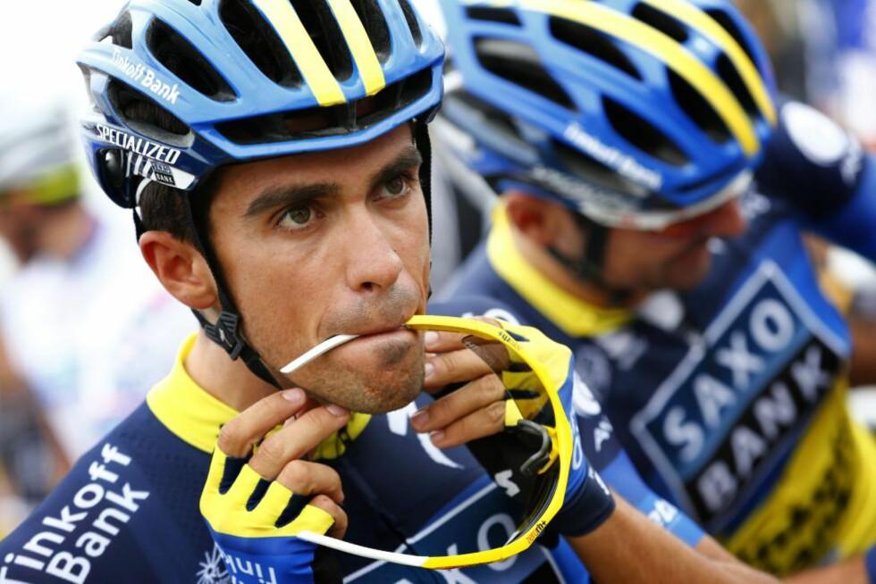 UTE ETTER REVANSJ: Alberto Contador stiller i sin første Grand Tour siden fjorårets Tour de France. Nå er «El Pistolero» klar for igjen å vise hvem som er verdens beste etapperytter i Vueltaen. Foto: VINCENT JANNINK / ANP / AFP PHOTO/ NTB Scanpix
