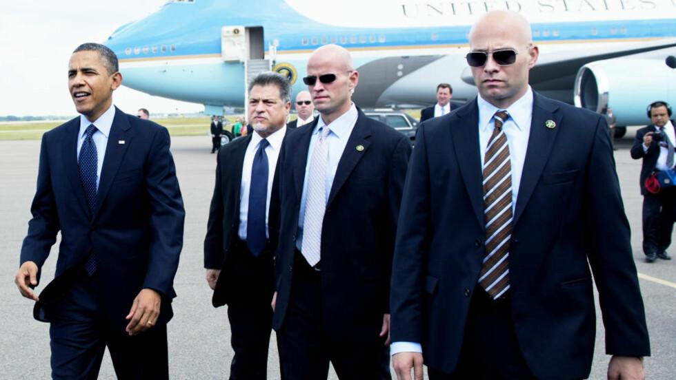 TØFFE GUTTER: Secret Service rommer verdens mest kjente livvaktstyrke, men skjemmes nå av sexkjøpanklager. Agentene på bildet er en del av livvakt-gruppa som til enhver tid følger Obama, og er ikke involvert i skandalen. Foto: SAUL LOEB / AFP / NTB SCANPIX