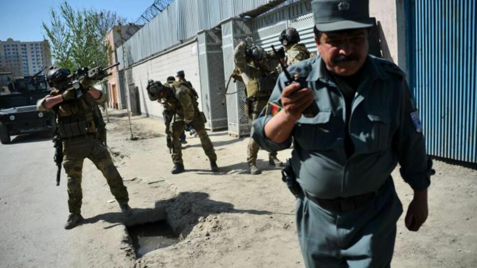 - NORSK SOLDAT: Her er en norsk enhet i aksjon sammen med de afghanske sikkerhetsstyrkene, ifølge nyhetsbyrået AFP. Foto: Bay Ismoyo / AFP / NTB Scanpix
