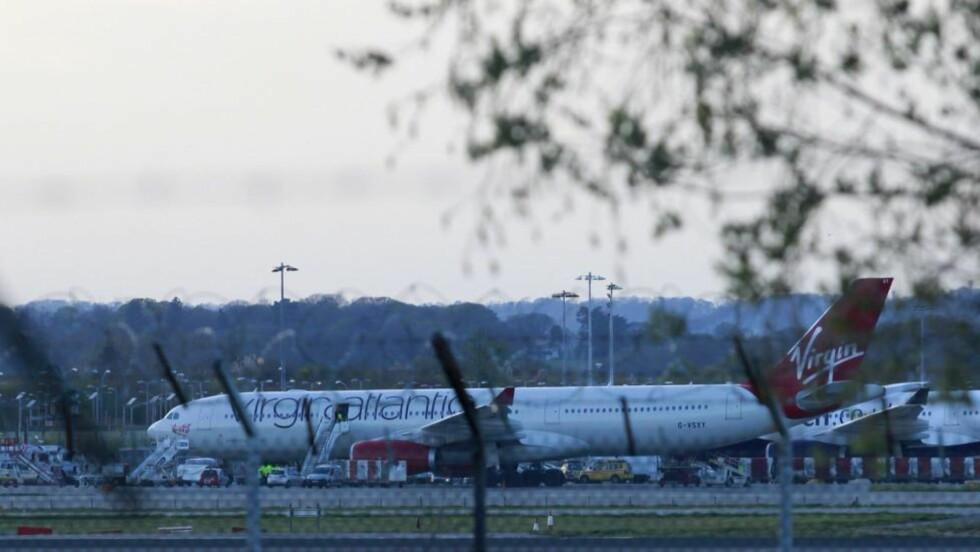 NØDLANDET: Dette Virgin Atlantic-flyet nødlandet på flyplassen Gatwick etter røykutvikling om bord i flyet. Foto: EPA/TAL COHEN/NTBSCANPIX