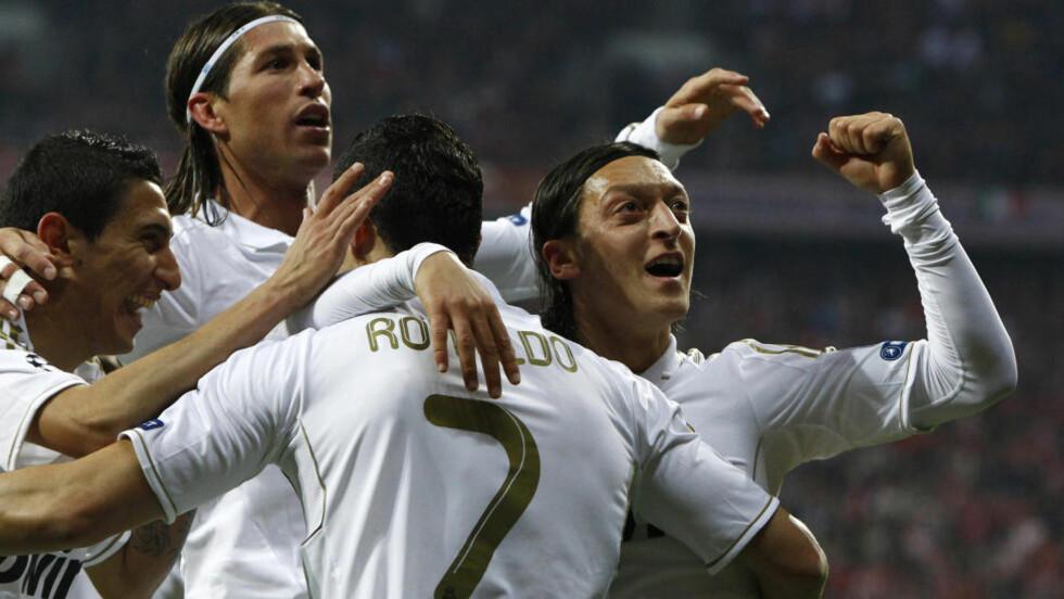 2-1: Real Madrid feirer mål i bortekampen mot Bayern München i semifinalen i Champions League. Hvor mange mål scorer Real Madrid på hjemmebane? Foto: REUTERS/Michaela Rehle
