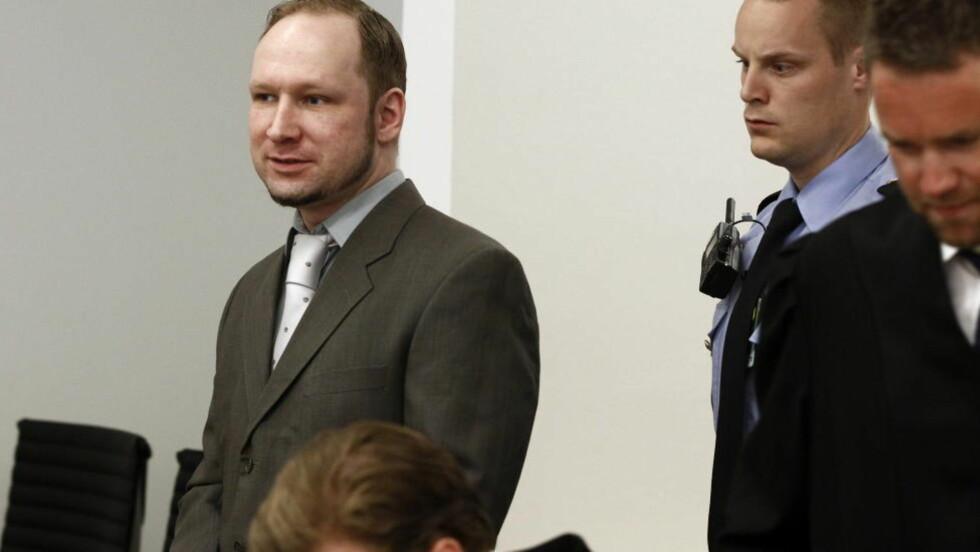 ENDRET MIMIKK:  Breivik smilte da barnemora fortalte om nyheter for barn.Foto: Lise Åserud / NTB scanpix