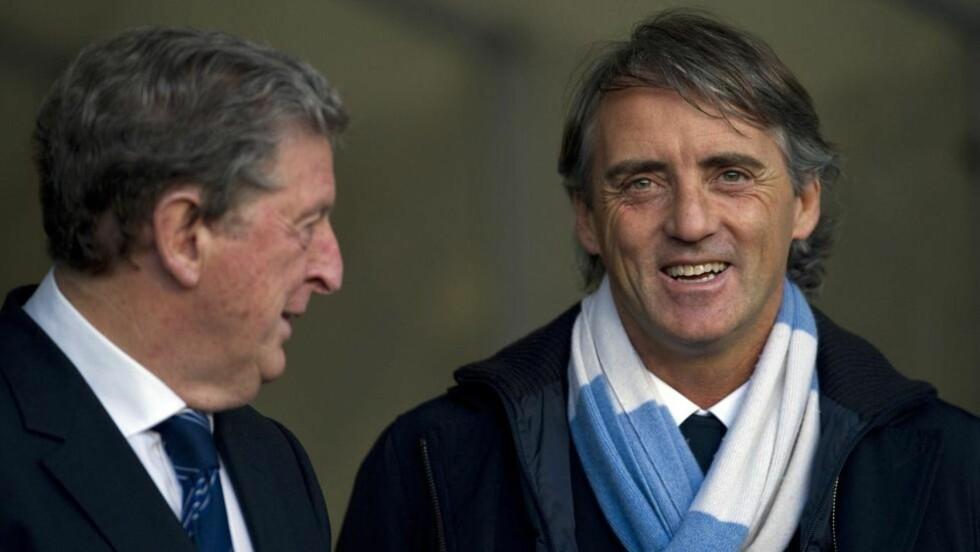 IKKE BEKYMRET: Manchester City-manager Roberto Mancini er ikke bekymret for å miste jobben om laget hans feiler i jakten på det engelske seriegullet. Foto: AFP Photo / Adrian Dennis / NTB Scanpix