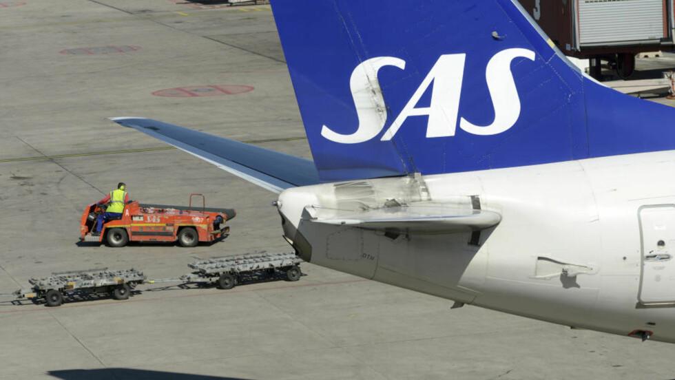 PILOT BLÅSTE RØDT: En pilot på et SAS-fly ble stanset etter å ha blåst rødt på Arlanda tirsdag morgen. Piloten skal ha hatt en promille på over 1,0. På bildet er et SAS-fly på Arlanda flyplass i Sverige. Foto: Johan Nilsson / Reuters / Scanpix