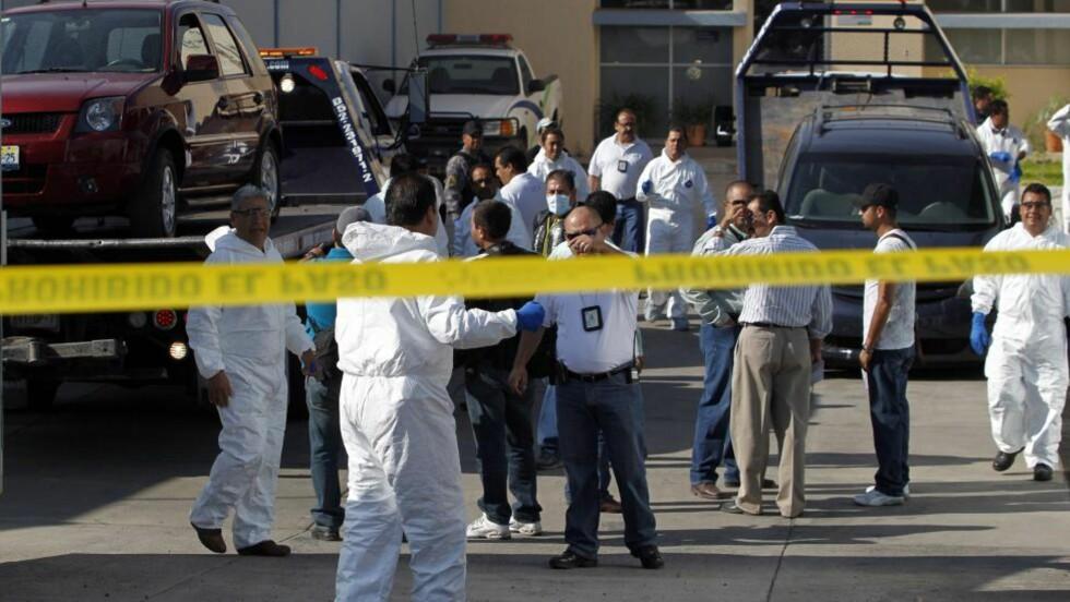 GRUFULLE FUNN: Politiet i Mexico fant 18 halshogde og parterte lik i småbyen Ixtlahuacan de los Membrillos utenfor Guadalajara. Foto: Ulises Ruiz Basurto /EPA / SCANPIX