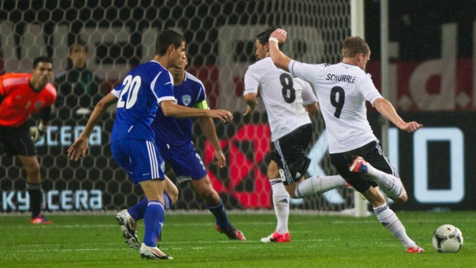 SUSER: Leverkusen-spiller Andre Schürrle kom på som innbytter for Tyskland og økte til 2-0 med et fantastisk langskudd. Foto: SCANPIX/EPA/JENS WOLF