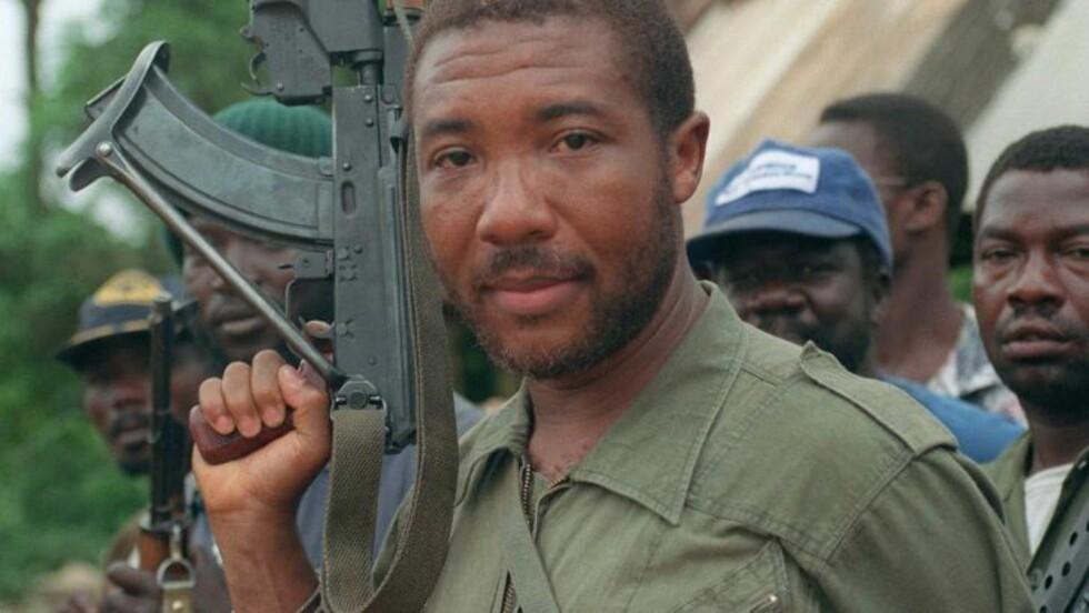 HYLLES: Despoten Charles Taylor, som trakk i trådene i borgerkriger i Liberia og Sierra Leone og loppet sitt land for naturressurser. Nå sitter han tiltalt i Haag. Foto: AFP/Scanpix
