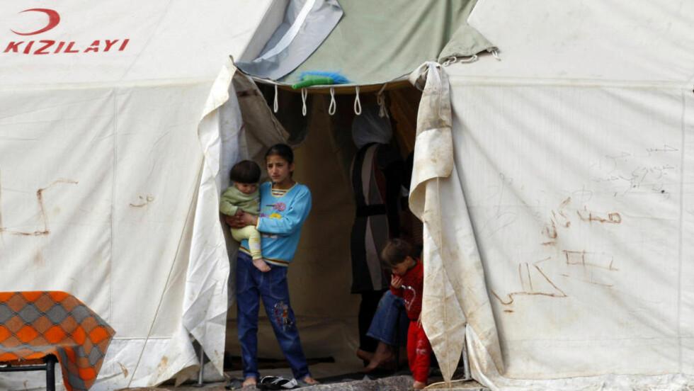 TRENGER HELP: Syria trenger sårt humanitær hjelp etter herjingene i landet. Foto: OSMAN ORSAL / SCANPIX