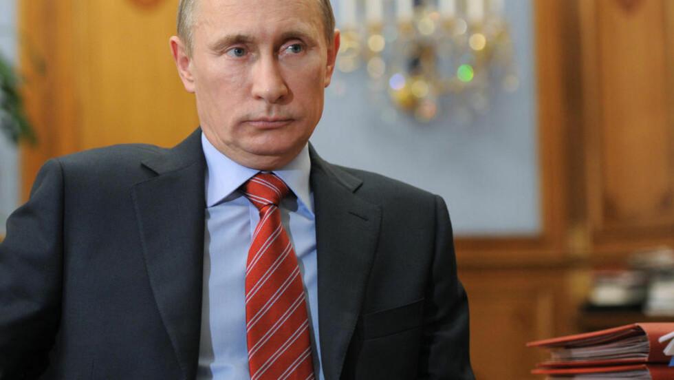 - VALGFUSK: Den russiske opposisjonen beskylder Vladimir Putin for valgfusk i forrige helgs valg. Nå varsler de demonstrasjoner i helga. Foto: AP Photo/RIA Novosti, Yana Lapikova/Scanpix