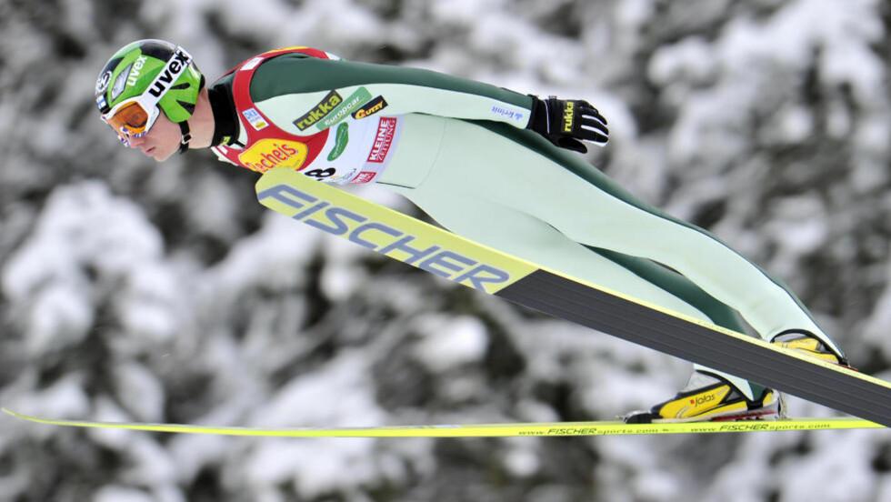 SKAL FLY UTEN SKI: Den finske kombinertløperen Hannu Manninen er nyutdannet pilot, og ble nettopp tobarnsfar. Nå kutter han ut skikarrieren. Foto: Kerstin Jönsson, AP/Scanpix