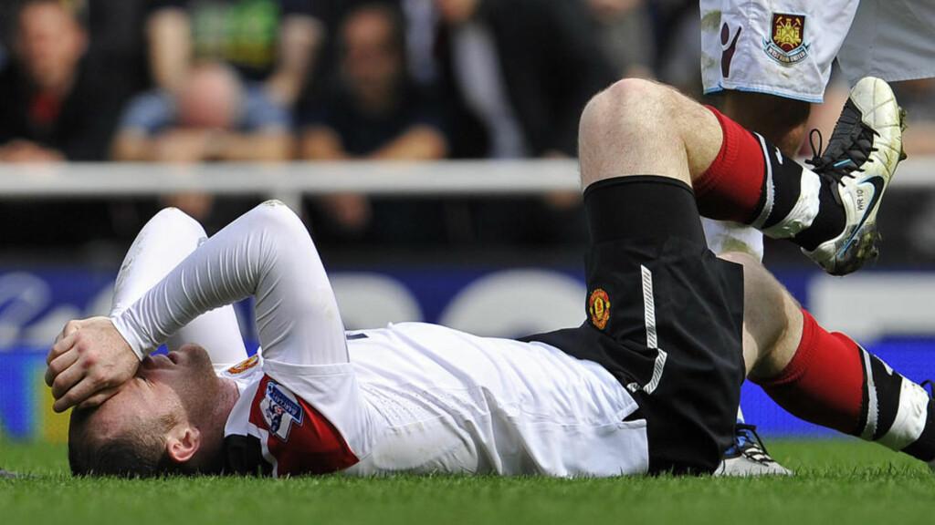 REISTE SEG MESTERLIG: Manchester United og Wayne Rooney lå på rygg etter første omgang mot West Ham. Men de røde, for anledningen hvite, kan aldri avskrives.Foto: SCANPIX/REUTERS/Toby Melville