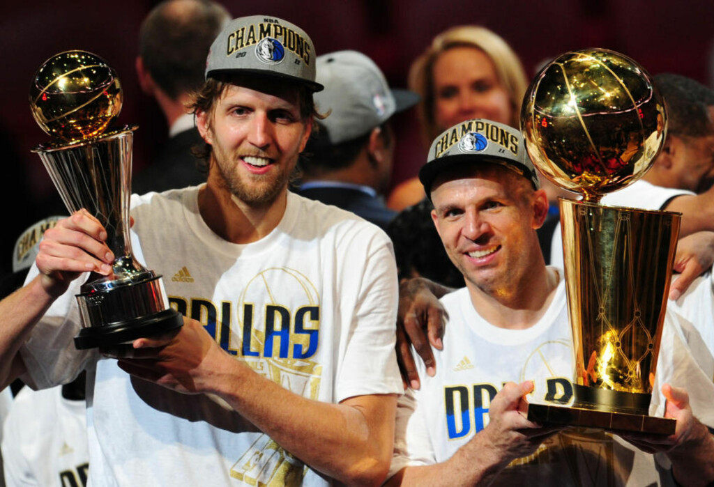 Dirk Nowitzki (L) and Jason Kidd (R) of the Dallas Mavericks hold the MVP and Larry O'Brien Trophies after defeating the Miami Heat in Game Six of the 2011 NBA Finals, at the AmericanAirlines Arena in Miami, Florida on June 12, 2011.      AFP PHOTO/Mark RALSTON
