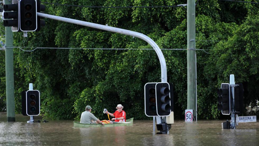 FREDELIG I BRISBANE: Det er stille etter stormen i Brisbane, Australia. - Surrealistisk fredelig, mener norsk student. AFP PHOTO / Torsten BLACKWOOD