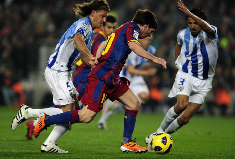 RYKKER FRA: Barcelona anført av Lionel Messi valset over Malaga på Camp Nou, og leder nå La Liga fire poeng foran Real. Foto: Josep Lago, AFP/Scanpix