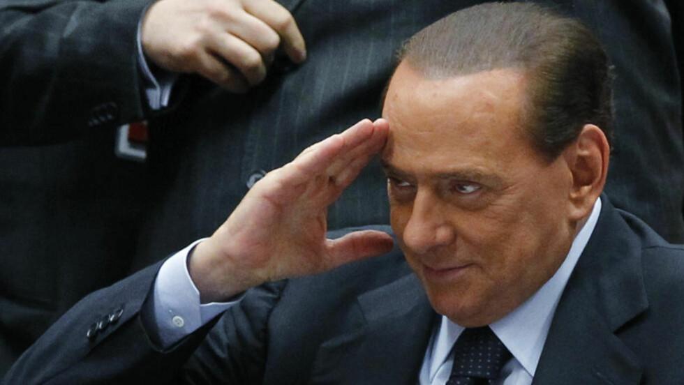 UNDER ETTERFORSKNING: Italias statsminister Silvio Berlusconi er under etterforskning etter at han skal ha gitt flere unge kvinner tilgang til leiligheter som betaling for sex. Foto: REUTERS/Francois Lenoir/SCANPIX