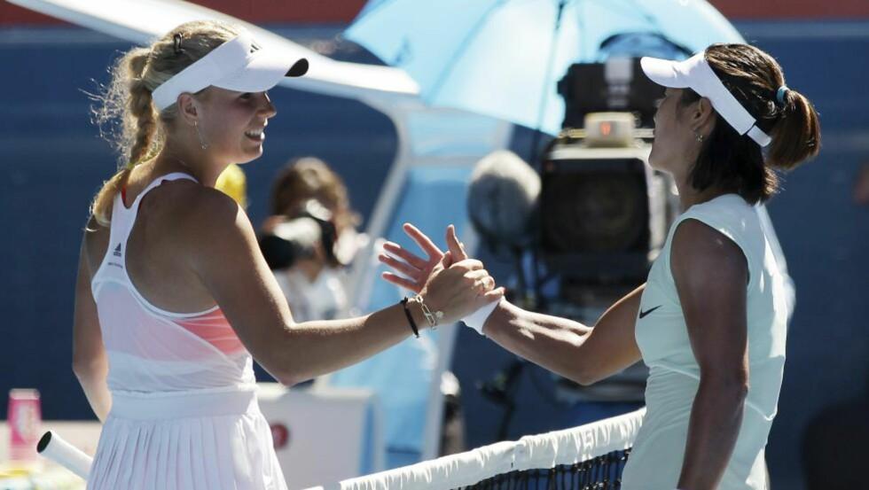 TAKK FOR FØLGET: Kinesiske Li Na blir ifølge NTB den første asiatiske Grand Slam-finalist etter semifinaleseieren over danske Caroline Wozniacki i Australia.Foto: SCANPIX/AP/Rob Griffith