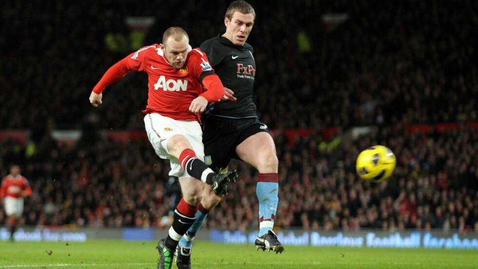 EFFEKTIV IGJEN: Wayne Rooney distanserte Richard Dunne etter 50 sekunder, og dunket inn sitt første mål.Foto: SCANPIX/EPA/ROGER PARKER
