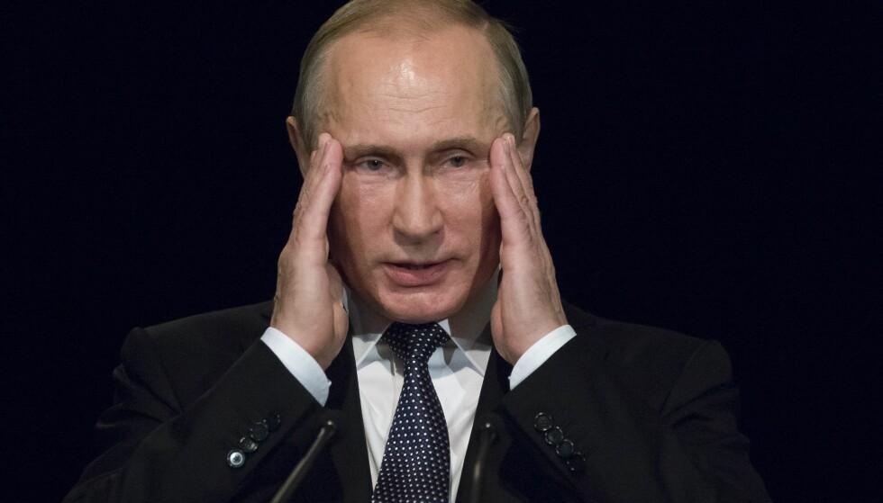 INTERNASJONAL HODEPINE: Vladimir Putin og Russland vil ikke bli medlem i Den internasjonale straffedomstolen. Foto: AP Photo/Alexander Zemlianichenko