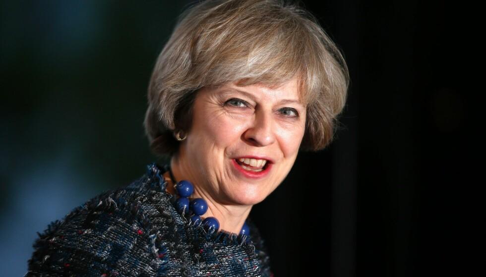 PLANEN KLAR: Theresa May lanserer søndag sin plan for hvordan Storbritannia skal melde seg ut av EU. Foto: AFP PHOTO / Adrian DENNIS / NTB scanpix