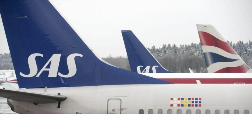 FORSINKELSER: - Vi har en gjennomsnittlig forsinkelse på 30 minutter, sier informasjonssjef Jo Kobro, ved Oslo lufthavn Foto: LEIF R. JANSSON/EPA/SCANPIX