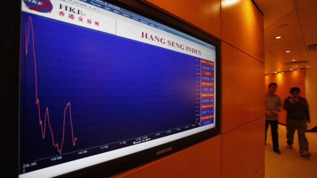 DYR KATASTROFE: Singapore-banken DBS anslår at naturkatastrofen vil koste den japanske økonomien over 565 milliarder kroner. Det tilsvarer rundt 2 prosent av brutto nasjonalprodukt BNP, det vil si den samlede verdien av varene og tjenestene landet produserer. Foto: REUTERS/SCANPIX